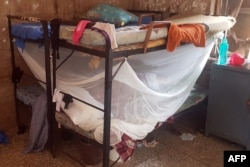 Student wares lie on a bed after 140 boarding students of Bethel Baptist School were kidnapped by gunmen in Kaduna, northwestern Nigeria, on July 5, 2021.