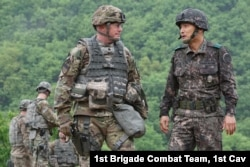 US Lt. Col. Douglas Hayes and Republic of Korea Army Col. Seong Ik Sung discuss the progress of a coordinated, joint artillery exercise May 10, 2016. (US Army photo)
