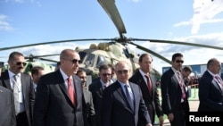 Russian President Vladimir Putin and his Turkish counterpart Recep Tayyip Erdogan visit the MAKS 2019 air show in Zhukovsky, outside Moscow, Russia, Aug. 27, 2019.