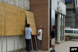 Locals board up their shops ahead of Tropical Cyclone Harold in Vanuatu's capital of Port Vila, April 6, 2020.