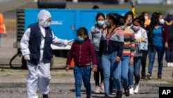 FILE - Unaccompanied Guatemalan children who were deported by plane from Mexico arrive at La Aurora International Airport in Guatemala City, Aug. 26, 2021, amid the COVID-19 pandemic.