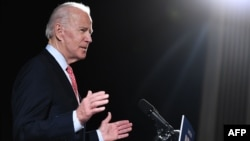 (FILES) In this file photo taken on March 12, 2020 former US Vice President and Democratic presidential hopeful Joe Biden speaks about COVID-19, known as the Coronavirus, during a press event in Wilmington, Delaware. - Former Vice President Joe…