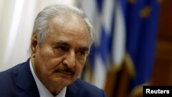 Libyan commander Khalifa Haftar meets Greek Prime Minister Kyriakos Mitsotakis (not pictured) at the Parliament in Athens, Greece, Jan. 17, 2020.