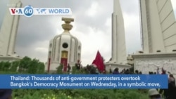 VOA60 Addunyaa - Anti-government protesters took over Bangkok's Democracy Monument after confronting pro-monarchists