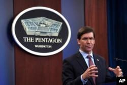 FILE - Defense Secretary Mark Esper speaks during a news conference at the Pentagon in Washington, Dec. 20, 2019.