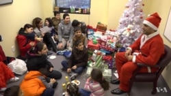 Santa Delights Refugee Children, Families at New Jersey Gathering
