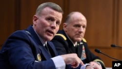 Gen. Tod D. Wolters, commander of U.S. European Command and NATO Supreme Allied Commander Europe, left, and Gen. Stephen Lyons, commander, U.S. Transportation command, right, testify before the Senate Armed Services Committee hearing, Feb. 25, 2020.