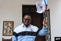 Tundu Lissu, the presidential candidate of Tanzania's main opposition Chadema party, speaks to the media at his home in Dar es Salaam, Sept. 9, 2020.