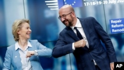 European Commission President Ursula von der Leyen, left, and European Council President Charles Michel bump elbows after addressing a media conference at an EU summit in Brussels, Tuesday, July 21, 2020. Weary European Union leaders finally…