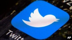 FILE - A Twitter app icon is pictured on a mobile phone. Millions of Nigerians were unable to access Twitter on June 5, 2021, after the government enforced an indefinite suspension of the microblogging platform's operations.