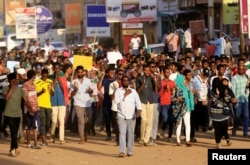 Sudanese demonstrators march during a protest in the capital Khartoum, Oct. 21, 2019.