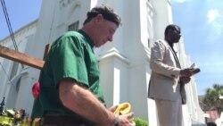 Pastors hold prayer outside Emanuel AME Church, Charleston, June 20, 2015.