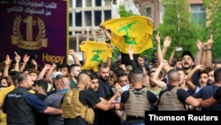 Lebanese army try to block supporters of the Lebanese Shi'ite groups Hezbollah and Amal as they gesture and chant slogans against anti-government demonstrators, in Beirut, June 6, 2020.