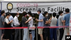 People queue in line to wait for the coronavirus testing at a Public Health Center in Seoul, South Korea, July 9, 2021.