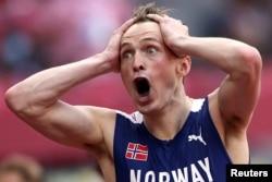 Karsten Warholm of Norway celebrates after winning gold, Aug. 3, 2021.