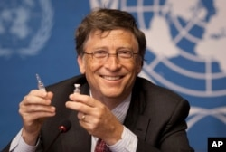 FILE - Microsoft founder Bill Gates holds a vaccine for meningitis during a news conference at U.N. headquarters in Geneva, Switzerland, May 17, 2011.