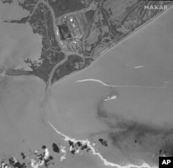 This satellite image provided by Maxar Technologies shows an overview of Port Fourchon, La., and oil slicks on Sept. 2, 2021.