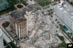 This aerial photo shows part of the 12-story oceanfront Champlain Towers South Condo that collapsed in Surfside, Fla., June 24, 2021. (Amy Beth Bennett /South Florida Sun-Sentinel via AP)