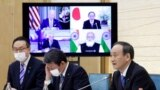 """Japan's Prime Minister Yoshihide Suga speaks during the virtual summit of the leaders of Australia, India, Japan and the U.S., a group known as """"the Quad"""", at his official residence in Tokyo, Japan, March 12, 2021."""