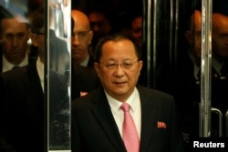 FILE - North Korean Foreign Minister Ri Yong-ho walks to speak to the media outside the Millennium hotel in New York, Sept. 25, 2017.