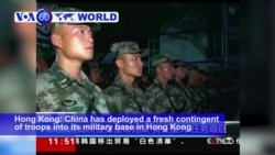 VOA60 World PM - China Rotates Fresh Troops into Hong Kong