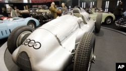 FILE - Visitors stand near the 1939 Auto Union D-type on display at the Retromobile vintage cars show in Paris, Friday Feb. 16, 2007. The car, one of the two still in existence, could have become the most expensive car ever but the auction has been postponed. (A