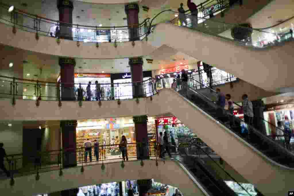 Egyptian shoppers roam a commercial mall in Cairo, Egypt, Oct. 31. The government is facing a backlash from businesses and the public as it vows to impose new nationwide rules closing stores and restaurants early