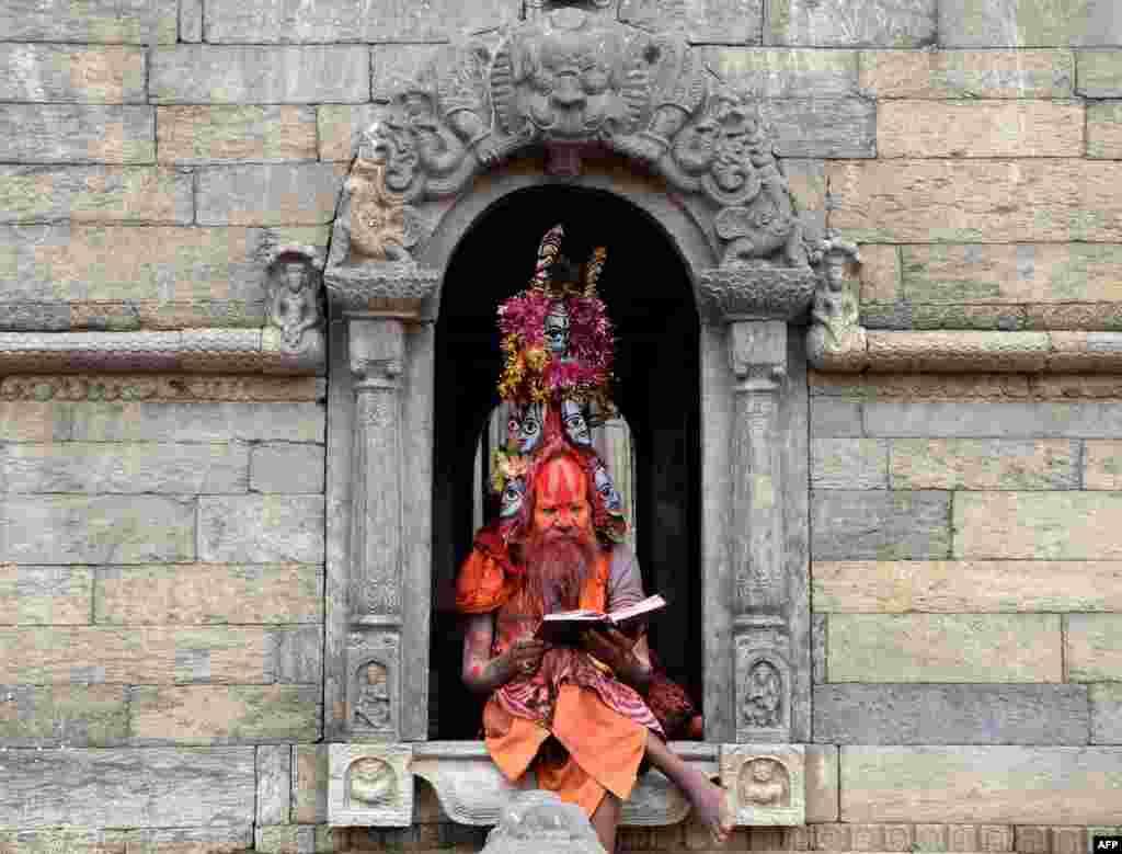 A Hindu holy man sits within the Pashupatinath temple in Kathmandu, Nepal.
