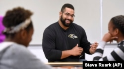 John Urschel teaches students at a STEM event near Baltimore in July.