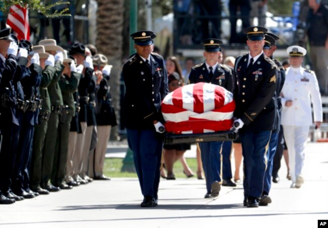 The Arizona National Guard carries the casket of Sen. John McCain, R-Ariz. during memorial service at the Arizona Capitol in Phoenix, Aug. 29, 2018.