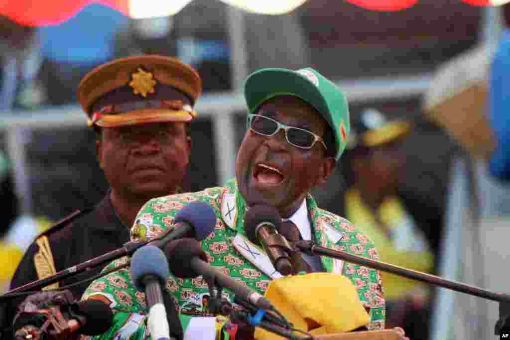 Zimbabwe President and Zanu-PF leader Robert Mugabe addresses party supporters at his last campaign rally in Harare, July 28, 2013.