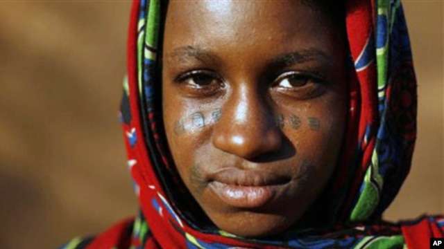 A young Fulani woman with traditional facial tattoos is seen in Niamey, Niger. Voters in Niger go to the polls this month in a referendum on changing the constitution, (File).
