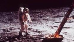 "Astronaut Edwin ""Buzz"" Aldrin walks by the footpad of the Apollo 11 Lunar Module in July 1969"
