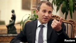 Lebanon's Foreign Minister Gebran Bassil talks during an interview with Reuters at his office in Beirut, Sept. 10, 2015.