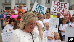 FILE - Laurie Holt, the mother of Josh Holt, an American jailed in Venezuela, cries during a rally at the Utah State Capitol in Salt Lake City, July 30, 2016.