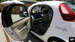 FILE - A Google self-driving car is on display at Google's I/O conference in Mountain View, Calif., May 18, 2016. Cars with no steering wheel, no pedals and nobody at all inside could be driving themselves on California roads by the end of 2017, under proposed new rules that would give a powerful boost to the technology from the nation's most populous state.