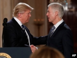 President Donald Trump nominates Neil Gorsuch (right) less than two weeks after becoming president.
