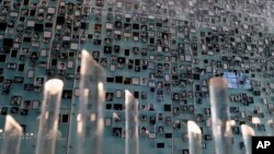 FILE - Pictures of missing people are displayed at the Memory and Human Rights Museum in Santiago, Chile. The new museum is dedicated to remember the tens of thousands of people imprisoned, tortured or killed during the dictatorship of Gen. Augusto Pinochet.