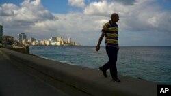 A man walks along the sea wall of Havana, Cuba, Jan. 13, 2017.