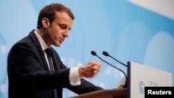 FILE - French President Emmanuel Macron speaks during the COP23 U.N. Climate Change Conference in Bonn, Germany, Nov. 15, 2017.