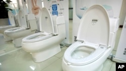 High-end Trump-branded toilets made by Shenzhen Trump Industrial Co. are on display at the company's offices in Shenzhen, China, Feb. 13, 2017. President Donald Trump recently secured trademark rights to his own name in China, after suffering rejection after rejection in that nation's courts. His prospects changed dramatically after he began running for president.
