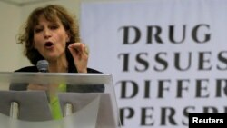 "FILE - Agnes Callamard, a United Nations Special Rapporteur on extrajudicial, summary or arbitrary executions, delicers a statement during a ""Drug issues, Different Perspectives"" forum at a compound of University of the Philippines in Quezon city, metro Manila."