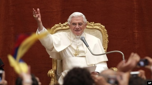 Pope Benedict XVI waves to faithful during a general audience in the courtyard of his summer residence at Castelgandolfo, in the outskirts of Rome, August 10, 2011