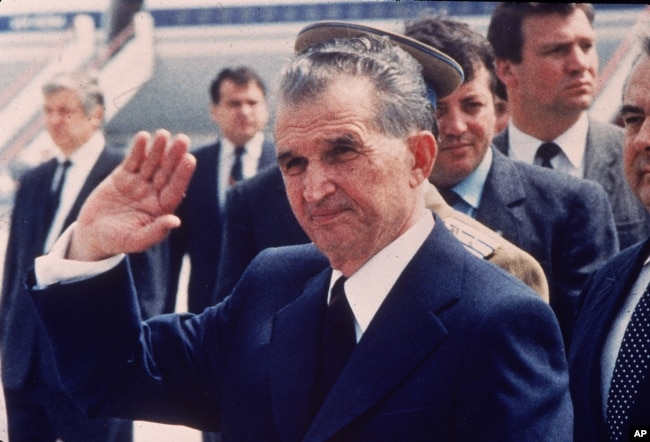 FILE - Romania's then-leader Nicolae Ceausescu is seen as he receives his Russian counterpart at Bucharest airport, in Bucharest, Romania, May 1987.