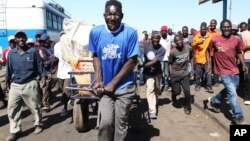 FILE: Former Mr. Ugly title holder William Masvinu seen working at a Market in Mbare, Harare, in this June, 14, 2012