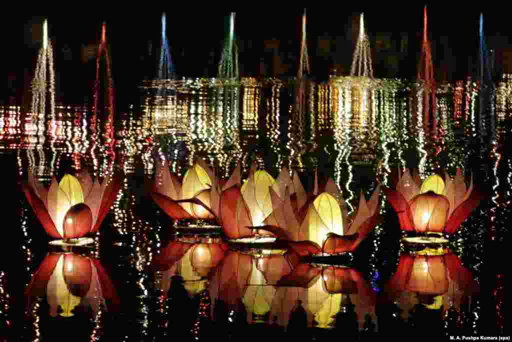 Lotus-shaped illuminated lanterns float during Vesak celebrations on Beira Lake in Colombo, Sri Lanka, to mark the birth, enlightenment and demise of Buddha.