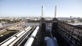 Two of the four iconic smokestacks of the former Battersea Power Station, which is to be redeveloped into retail units and housing by a Malaysian consortium, are seen in London, September 5, 2012.
