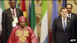 A video grab taken from AFP footage on June 26, 2014 shows African Union (AU) President Nkosazana Dlamini-Zuma and Spanish Prime Minister Mariano Rajoy attending the opening of an African Union (AU) summit in Malabo, Equatorial Guinea, on June 26, 2014.