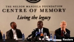 Deputy Chief Justice Dikgang Moseneke (C) reads Mandela's will as he is flanked by Professor Njabulo Ndebele (L) and Advocate George Bizos, Nelson Mandela's lawyer, confidant and friend at the Nelson Mandela Center of Memory in Houghton, Feb. 3, 2014.
