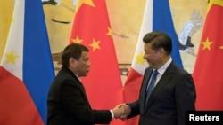 杜特尔特2016年上任后不久就去北京见习近平(路透社)